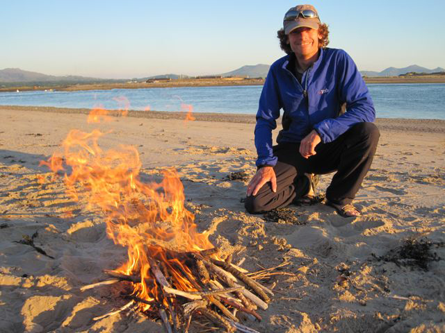 Andy with bonfire on the beach
