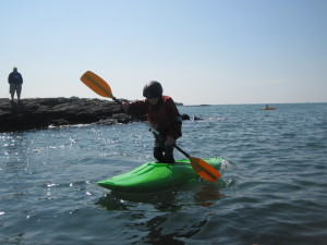 Boy kayaking standing up.