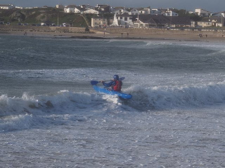 kayak surfers Trearddur Bay