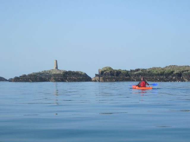 Kayaker heading for Rhoscolyn Beacon